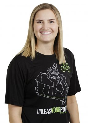 Headshot of Lauryn Friesen wearing Unleash Your Potential shirt