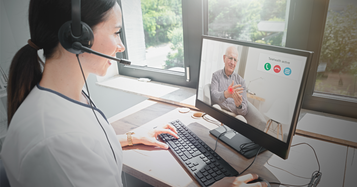 Female healthcare worker providing telehealth appointment to elderly man